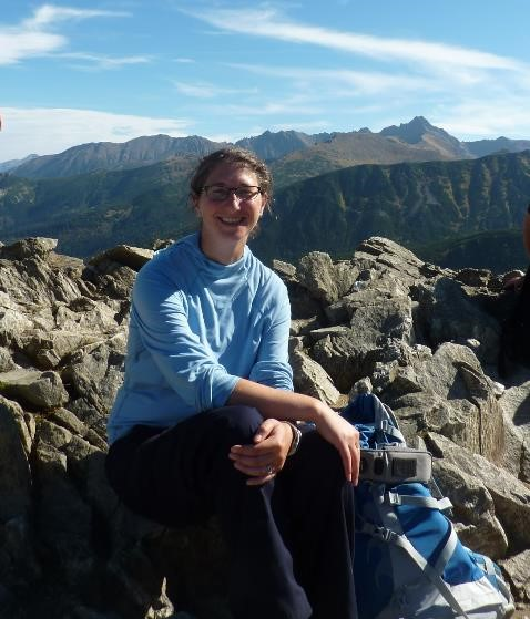 Kate at the top of a mountain near Zakopane, taking a break from her proofreading and copy-editing services