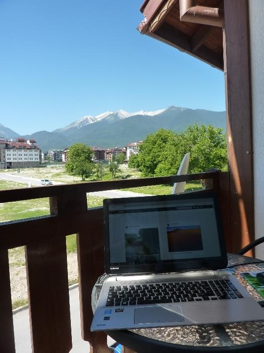 Office with a view: proofreading with the backdrop of Bulgarian mountains